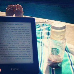 A good book and iced coffee, poolside.